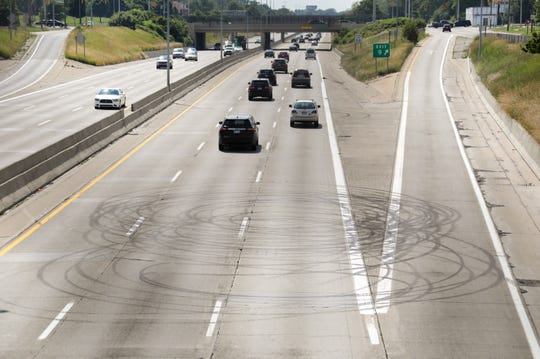 Burnout marks are visible across the northbound lanes at the Lodge in Detroit at the Livernois exit viewed from the Dexter Avenue overpass on Monday, July 1, 2019.