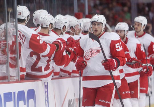 Detroit Red Wings center Valtteri Filppula (51) celebrates with teammates after scoring a goal against the Chicago Blackhawks in the third period of game two of the second round of the 2013 Stanley Cup Playoffs at the United Center. The Red Wings won 4-1.