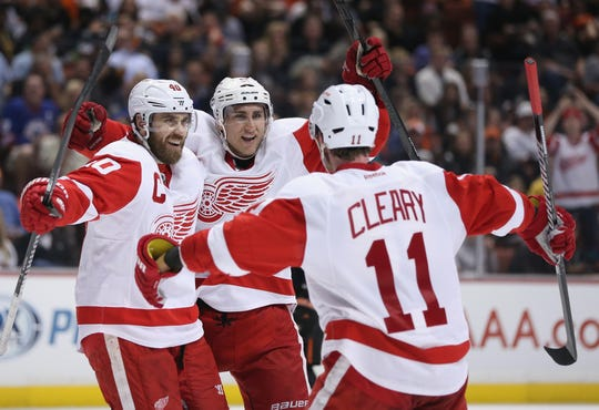 Left to right: Henrik Zetterberg, Valtteri Filppula and Daniel Cleary celebrate Filppula's goal in the second period against the Anaheim Ducks in Game 7 of the Western Conference first round at Honda Center on May 12, 2013 in Anaheim, Calif.