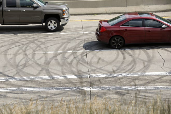 Burnout marks are visible across the northbound lanes at the Lodge in Detroit at the Livernois exit on Monday, July 1, 2019.