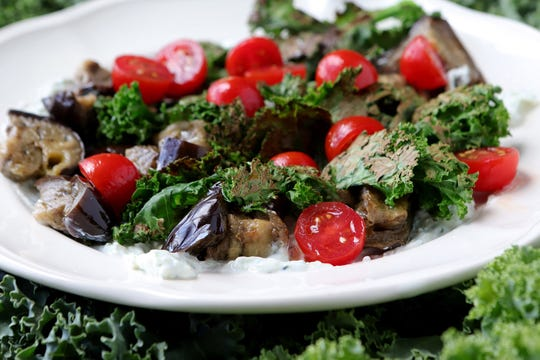 A dish featuring kale is this Roasted eggplant with crispy kale with yogurt.