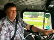 Truck driver Terry Button drives his truck near Opal, Va., Thursday, June 13, 2019. The Transportation Department is poised to relax the federal regulations that govern how many hours a day truckers can be behind the wheel, a long sought goal of the trucking industry.