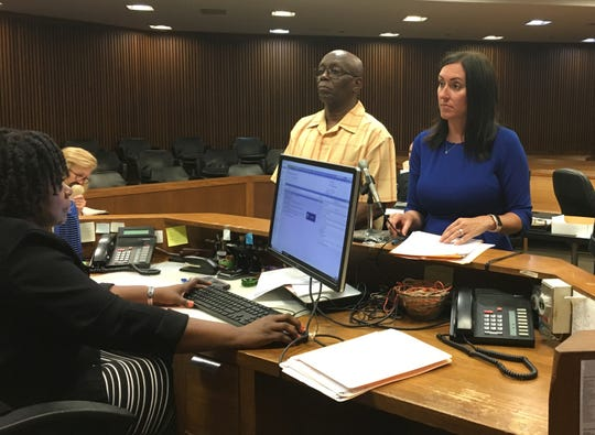 Ted Kelly stands with attorney Stephani LaBelle, of the City of Detroit's Project Clean Slate program on July 1, 2019 to receive his expungement from Wayne County Circuit Court Judge James R. Chylinski (not pictured).