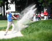 Tournament winner Nate Lashley hits out of bunker on the 11th hole at the Rocket Mortgage Classic at the Detroit Golf Club in Detroit on June 30, 2019.