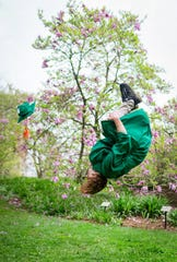 """Graduate in Full Bloom,"" by Camille Biggs of East Lansing. Michigan State computer engineering graduate Frankie Riviera does a celebratory backflip."