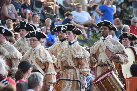 "A fife-and-drum parade at Greenfield Village's annual ""Salute to America"" holiday celebration Wed.-Sat."