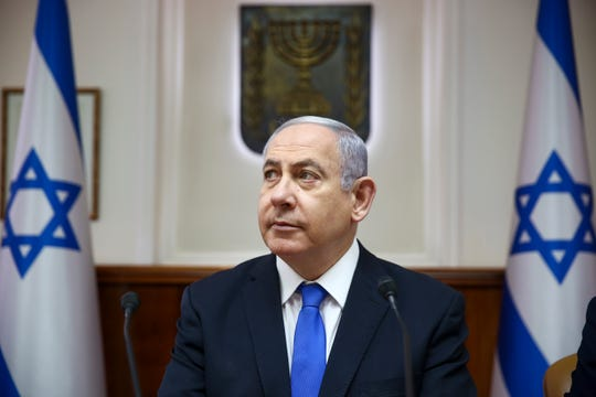 Israeli Prime Minister Benjamin Netanyahu chairs the weekly cabinet meeting at his office in Jerusalem.
