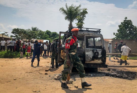 Congolese security forces attend the scene after the vehicle of a health ministry Ebola response team was attacked in Beni, northeastern Congo Monday, June 24, 2019. The Democratic Republic of Congo is preparing to send troops to remove illegal miners from a Glencore Plc mine where at least 43 people died last week.
