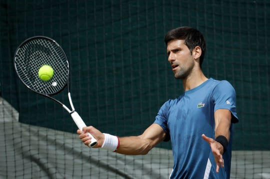 Novak Djokovic is ranked No. 1 and beginning his bid for a fifth title at the All England Club.