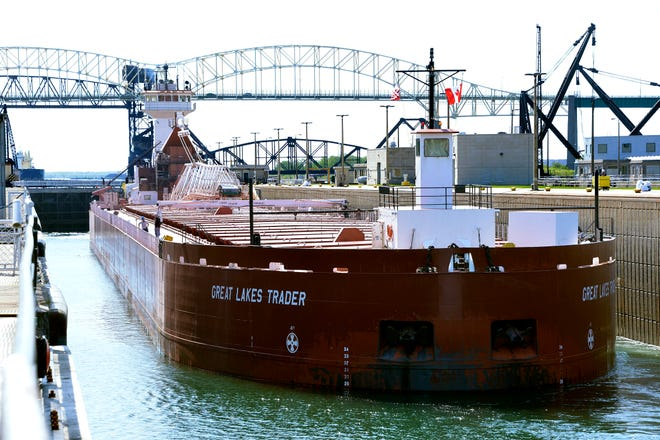 The Great Lakes Trader passes downstream through the Poe Lock in Sault Ste. Marie.