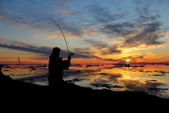 """Sunset Fishing,"" by Tyler Chandler of Clarkston. Michigan Tech student Chandler captures his roommate Matt Krause fishing in Lake Superior."