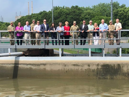 Eleven members of Michigan's congressional delegation visit the Brandon Road Lock and Dam near Joliet, Illinois, on Monday, July 1, 2019.