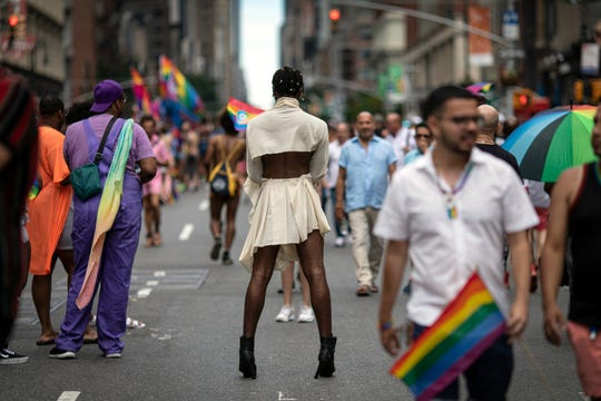 Parade-goers pose for photographs during the LBGTQ Pride march on Sunday, June 30, 2019, in New York, to celebrate five decades of LGBTQ pride, marking the 50th anniversary of the police raid that sparked the modern-day gay rights movement.