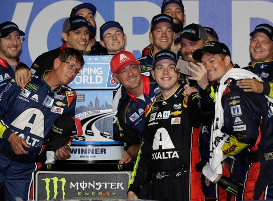 Alex Bowman takes photos of him and his crew after winning the NASCAR Cup Series race at Chicagoland Speedway on Sunday.