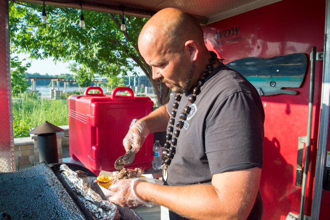 Nick Rose loads up some nachos from his food truck Tri-R-Tips Hawaiian style BBQ during during Friday After 5 in Downtown Owensboro, Ky. Friday, June 28, 2019.