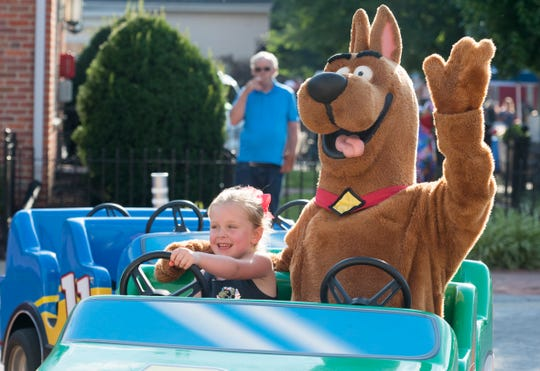 "Kinley Tolson, 4, takes a ride with ""Scooby Doo"" during Friday After 5 in Downtown Owensboro, Ky. Friday, June 28, 2019."
