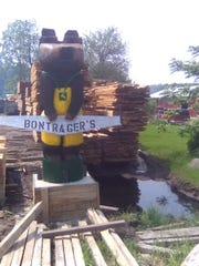 Bontrager's Sawmill is easily found as their carved bear stands guard by the road.