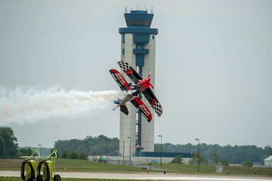 Skip Stewart flies tail down in front of the Fort Wayne International Airport Observation Tower during the Fort Wayne Air Show.