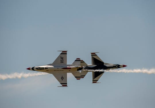 Thunderbird #5 (left) piloted by Maj. Matt Kimmel and #6 piloted by Michelle Curran cross in a knife-edge pass at 1,000 mph.