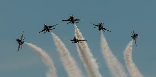 A close up, head-on shot of the Air Force Thunderbirds in Delta Burst formation
