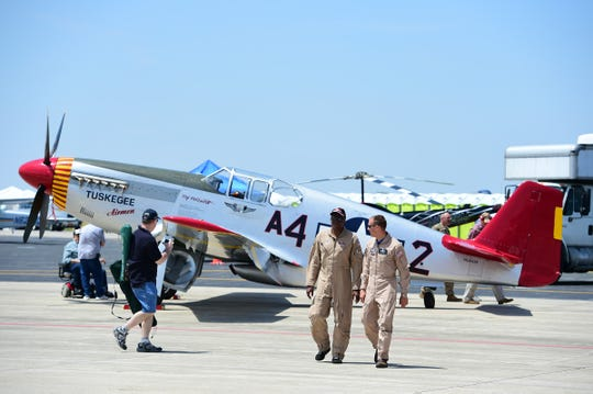 A P-51 Mustang aircraft was the model used by the famous Tuskegee Airmen; this one was on display at the Fort Wayne Air Show where attendees could also watch a film about the Tuskegee Airmen.