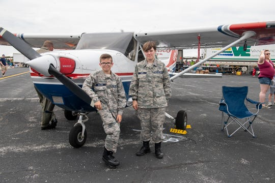 Alice Geyer, Wabash, IN, is a Master Sergeant in the Civil Air Patrol; an auxiliary group that introduces young people between the ages of 12 and 17 to the U.S. Air Force before they are old enough to choose whether or not to join any branch of the military. Geyer says that the Air Patrol teaches responsibility, respect and selflessness. Jace Bullins, also from Wabash, IN is in his first year of the Civil Air Patrol. They posed in front of a Cessna 182 owned by the Air Patrol which was parked on the tarmac at the Fort Wayne Air Show and were there to educate the public about the Air Patrol.