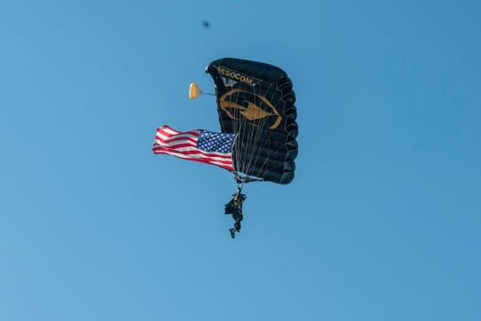 US Special Operations Para-Commandos jump into Parkview Stadium to open the Friday Night Thunderbirds Welcome Party the day before the opening of the 2019 Fort Wayne Air Show.