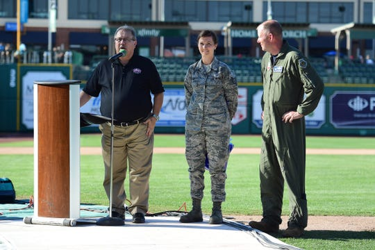 WOWO Radio Station's Pat Miller (left) emceed the Friday Night Thunderbirds Welcome Party at Parkview Field. Vice Commander Colonel Kyle J. Noel (far right) commended Staff Sergeant Whitney Myers for her work in helping plan the air show.