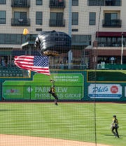 US Special Operations Para-Commando comes in for a landing on Parkview Field during the Friday Night Thunderbirds Welcome Party.