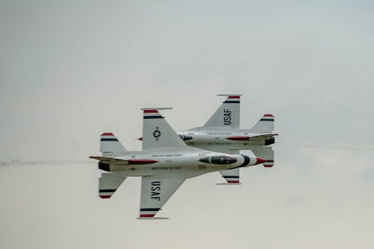 The two lead pilots, Maj. Matt Kimmel in jet # 5 and Michelle Curran in jet # 6 execute a knife-edge pass.