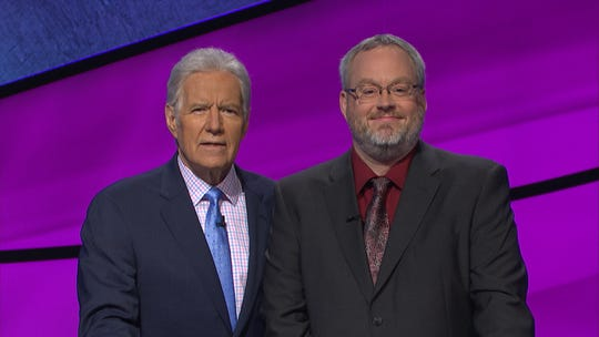 "Loveland librarian Charlie Jorgenson with ""Jeopardy"" host Alex Trebek."