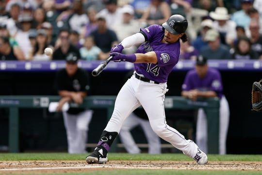 Catcher Tony Wolters, shown hitting a triple Sunday in a loss to the Los Angeles Dodgers, and the Colorado Rockies begin a two-game series at home against the Houston Astros at 6:40 p.m. Tuesday at Coors Field in Denver.
