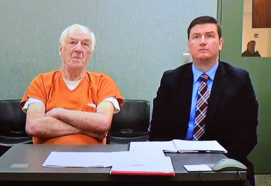 Raymand L. Vannieuwehoven, left, and his attorney Lee Schuchart, are seen by video conference during the Lakewood man's arraignment Monday morning (July 1, 2019) in Marinette County Circuit Court on two counts of first degree murder over the slayings of a Green Bay couple 43 years ago.