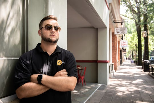 """Justin Roberson, of Greenville, on Main Street. """"You can root for all the good parts, but if you are blind to the areas where we it needs drastic improvement, I don't think you can call that patriotism,"""" said Roberson."""