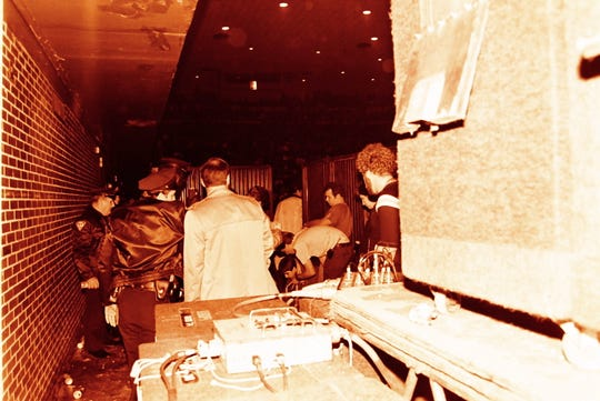 Paramedics attend to an injured man. The man, a KISS crew member attempted to put out a fire at Greenville Memorial Auditorium, but fell to his death from the ceiling ahead of the Jan. 3, 1985 show.