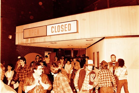 Crowds gather outside of Greenville Memorial Auditorium on Thursday, Jan. 3, 1985, where KISS was set to play. All spectators were evacuated from the venue after a crew member attempting to put out a fire fell to his death from the auditorium's ceiling.