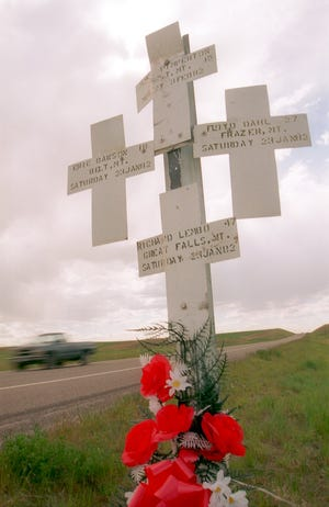 Roses decorate the crosses that stand along U.S. Highway 89 in memory of four Montanans who died in a traffic accident years ago.