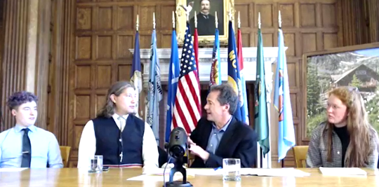 Gov. Steve Bullock discusses climate change Monday with, from left, Valan Anthos, Avery S. Old Coyote and Sula Duncan.
