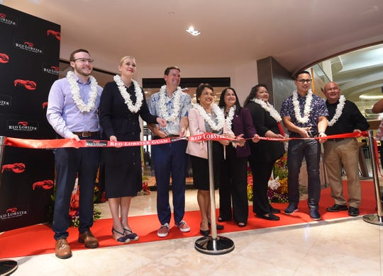 A ribbon cutting ceremony is held for the Red Lobster grand opening at Tumon Sands Plaza on July 1, 2019. From left: Brandon Sanders, Red Lobster International Operations manager, Catherine Souders, Red Lobster International Operations, Asia director, Jarrett Whitlow, Red Lobster International Operations senior director, Gov. Lou Leon Guerrero, Speaker Tina Muna Barnes, Tamuning Mayor Louise C. Rivera, Chris Duenas, Triple J Enterprises, Inc. chief financial officer, and Franklin Tretasco, Red Lobster Guam Franchise general manager.