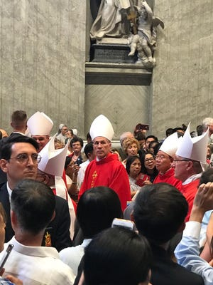 Archbishop Michael Jude Byrnes, center, during the June 29 pallium Mass in Rome.
