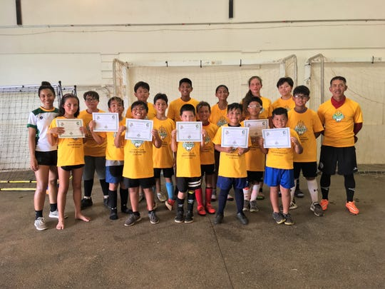 Some University of Guam Soccer Camp participants earned their camp certificates in June.