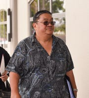 Retired Guam Police Department officer, John T. Mantanona, approaches the District Court of Guam entrance for a court hearing in Hagåtña on July 1, 2019.