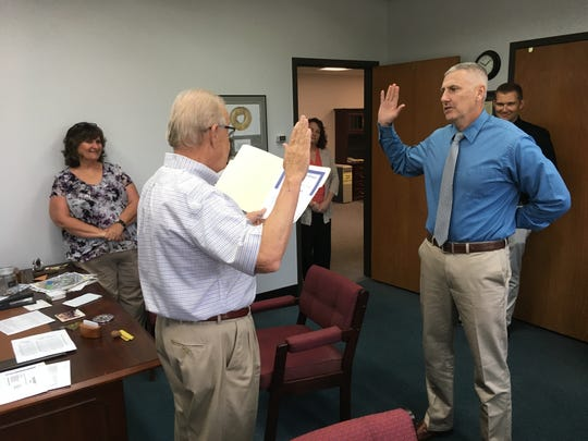 Sean McKinney gets sworn in on Monday morning in Mayor Steve Austin's office witnessed by Human Resources Director Connie Galloway and Henderson Police Chief Heath Cox.