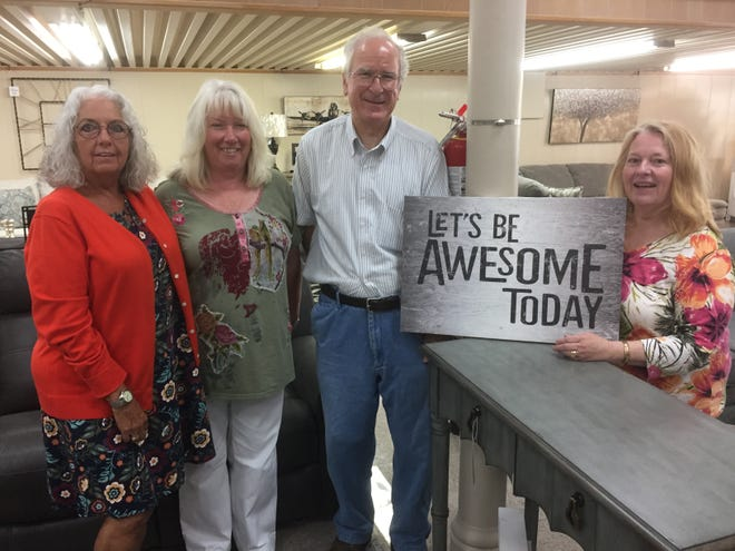 The new owners and longtime staffers at Alles Brothers Furniture posed for a photo moments before opening on Monday. From left they are Barbara McChesney, Pam Burke, Jack Alles and Marcia Alles.