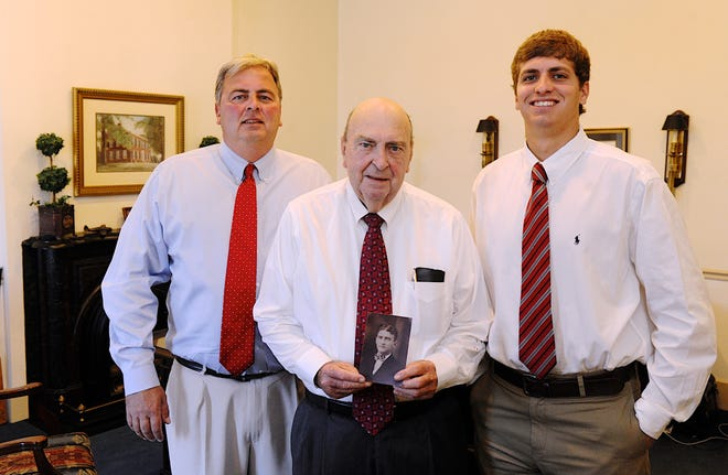 In this file photo from 2015, four generations of the Neel family (from left) Mac Neel, his father Malcom Neel, and son Patrick Neel pose in their office on First Street. Malcolm is is holding a portrait of his father, the late James Neel (who was one of the first 200 CPAs licensed in Kentucky), from 1929.