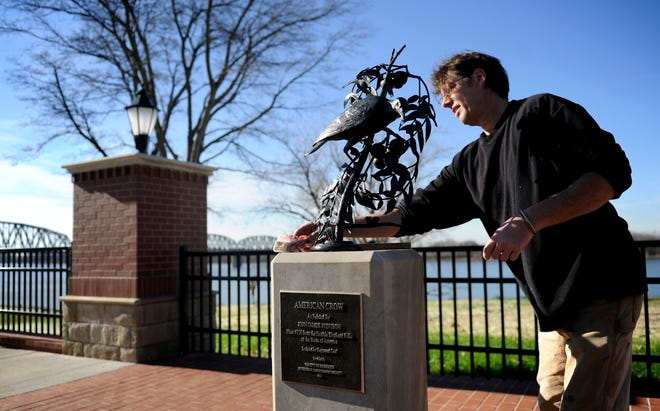 Louisville sculpture Raymond Graf at work in 2012 mounting his Audubon American Crow sculpture to it's base at the new overlook along the River Walk at Seventh Street. During the visit, Graf also put in place his sculpture of the Belted Kingfisher at the new River Walk entrance at 12th Street.