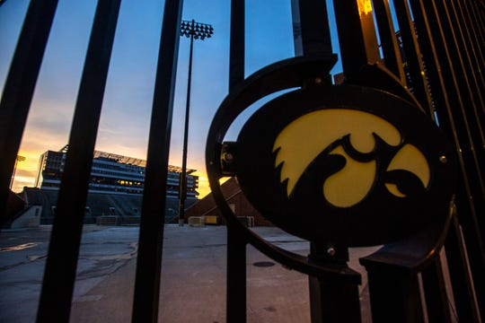 A Tigerhawk logo on an entrance gate is pictured as the sun sets, Sunday, June 30, 2019, at Kinnick Stadium in Iowa City, Iowa.