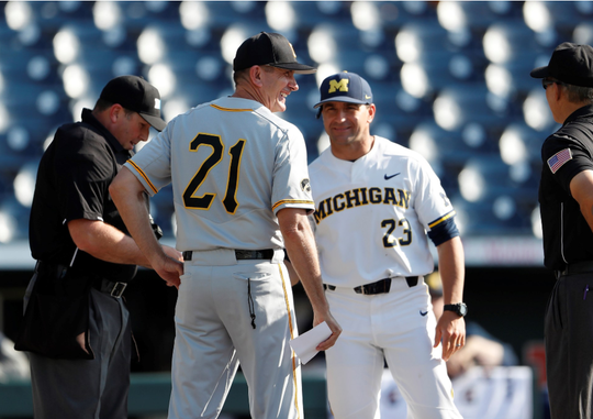 Iowa's Rick Heller, pictured here with Michigan coach Eric Bakich during the 2018 Big Ten Tournament, understands the importance of the Wolverines' 2019 College World Series run.