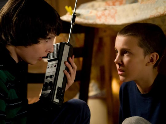 "Finn Wolfhard, left, portrays Mike Wheeler and Millie Bobby Brown portrays Eleven on Netflix series ""Stranger Things."""