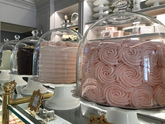 A dozen layer cake flavors including raspberry champagne, carrot cake, carmel  cake and gluten-free chocolate peanut butter crunch line the pastry case at Cake Bake Shop. The restaurant and bakery opened July 1, 2019, at Carmel City Center, 800 S. Rangeline Road.